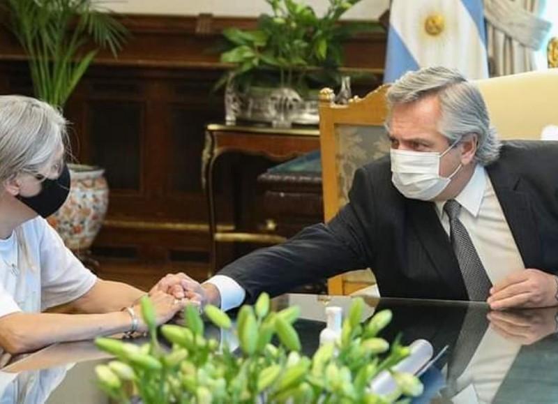 Patricia con el presidente.